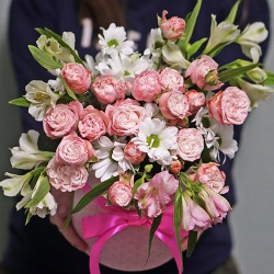 A Bouquet of flowers in a hat box of roses, Alstroemeria and daisies